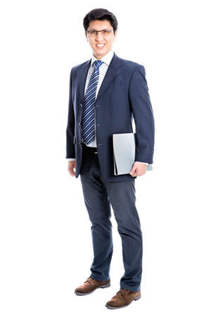 Young business man pointing to white background Stock Photo - 21258411