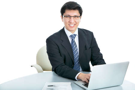Happy business man sitting in front of laptop on a white background Stock Photo - 21252973