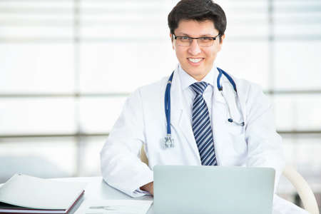 Medical doctor working with laptop in the hospital Stock Photo - 21258456