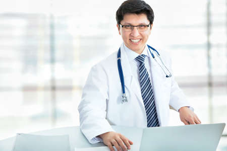 Medical doctor working with laptop in the hospital Stock Photo - 21258457
