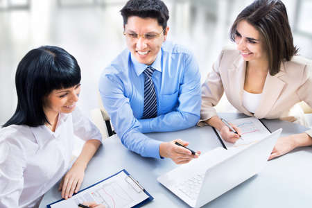 financial executive: Business team working on their business project together at office