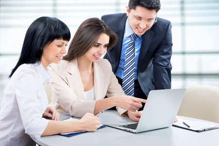 financial planner: Business team working on their business project together at office