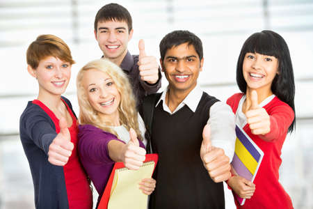 energetic people: Group of happy students giving the thumbs-up sign
