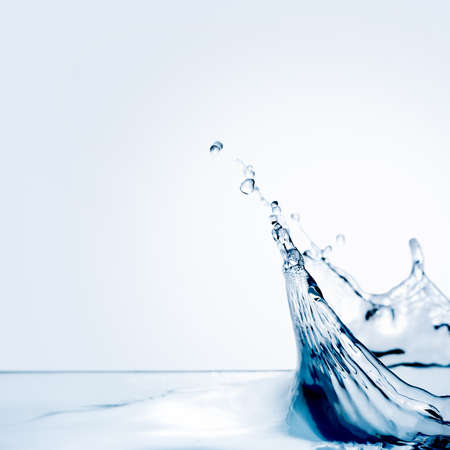 Beautiful splash of water falling from a slice of lemon photo