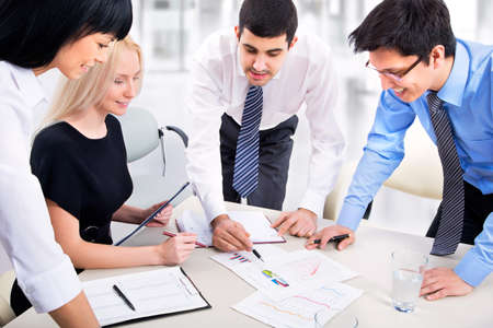 people interacting: Business team working on their business project together at office