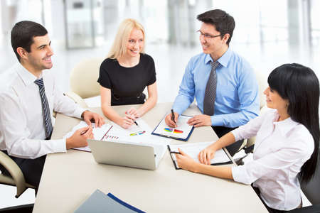 international organization: Business people working with laptop in an office Stock Photo