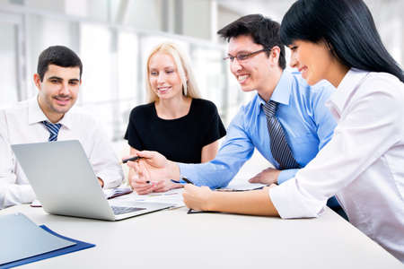 Business people working with laptop in an office Stock Photo
