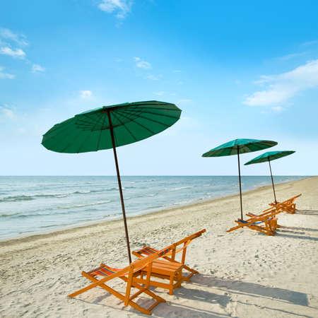 recliner: Beach chairs and umbrella on tropical sand beach.