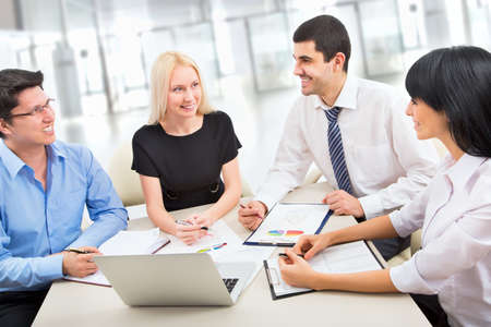 Boardroom meeting: Business people working together in an office
