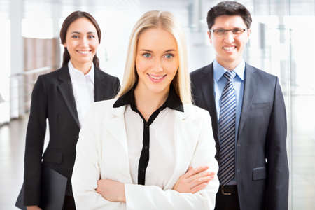 group leader: Group of business people with business woman leader on foreground Stock Photo
