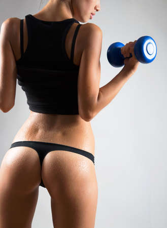 Fitness woman. Slim woman with dumbbells. Stock Photo