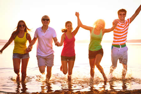 Group of young people at the beach of sea