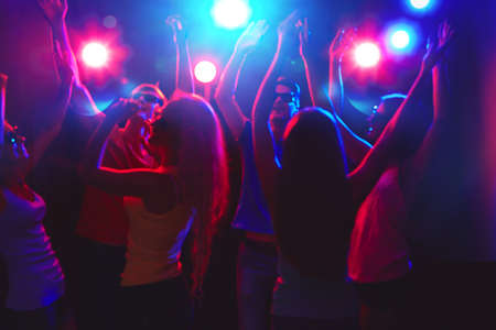nightclub crowd: Young people having fun dancing at party. Stock Photo