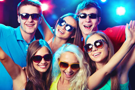 group of young adults: Young people having fun dancing at party. Stock Photo