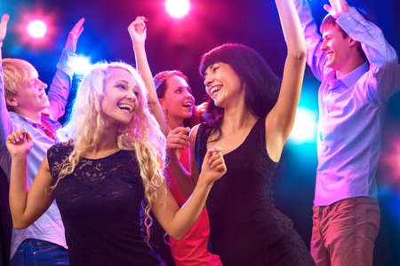 Young people having fun dancing at party. photo