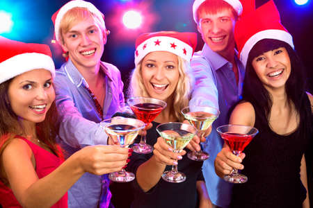 adult christmas: Happy people in santa hat clinking by glasses with you