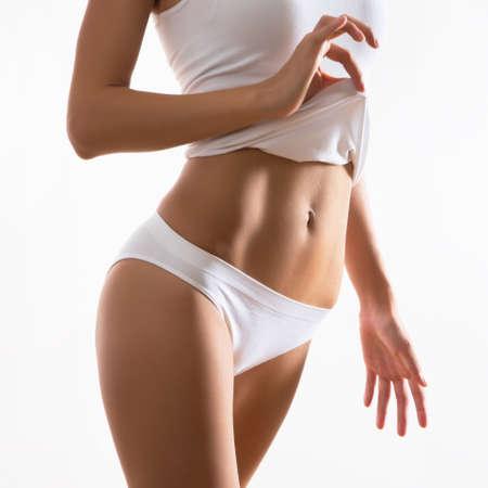 Corpo magro bonito da mulher em lingerie Imagens