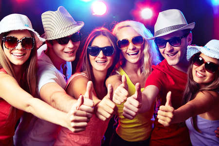okay sign: Happy young people show thumb up Stock Photo