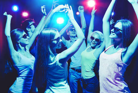 dance bar: Young people having fun dancing at party. Stock Photo