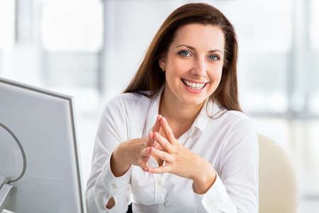 Portrait of business woman working with computer