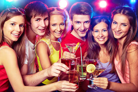 surprise party: Happy people clinking by glases with each other