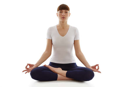 Healthy life. Young  woman doing yoga isolated on white background. photo