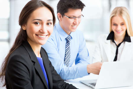 business training: Business woman and her collegues working together in an office