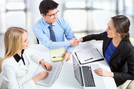 group strategy: Friendly handshake on business meeting in the office
