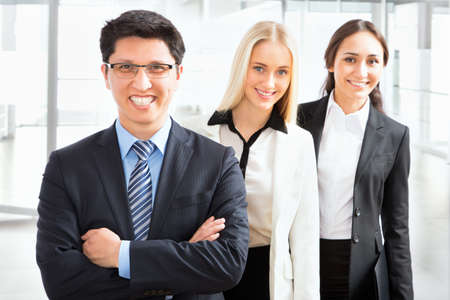 Group of business people with businessman leader on foreground Stock Photo - 24949880