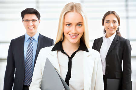 Group of business people with business woman leader on foreground Imagens