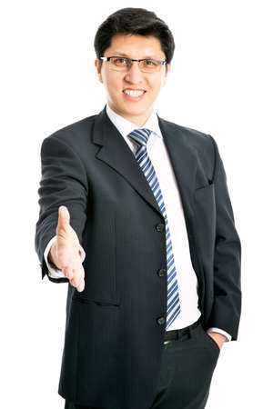welcome smile: Young successful businessman giving a handshake Stock Photo