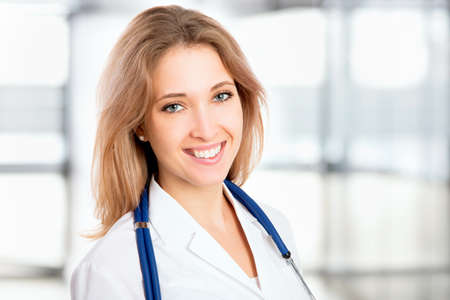 stethoscope girl: Young female doctor at the hospital Stock Photo