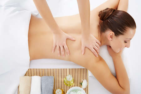 body massage: Masseur doing massage on woman body in the spa salon. Beauty treatment concept.