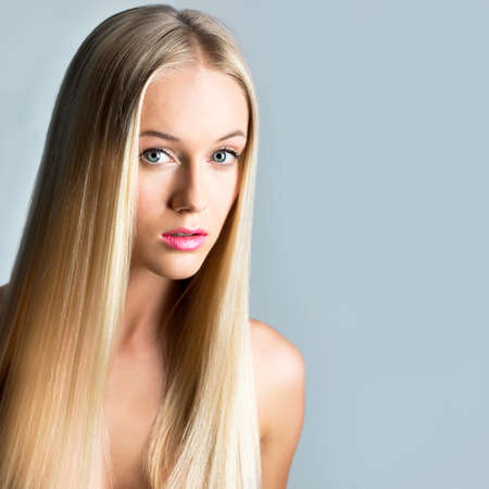 Beautiful young woman  with a long hair Stock Photo