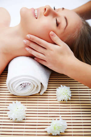 Masseur doing massage on woman face in the spa salon. Beauty treatment concept. Imagens