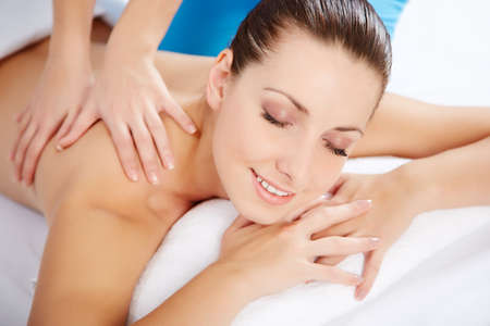 body massage: Healthy life. Young beautiful woman relaxed in spa environment Stock Photo