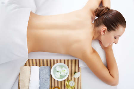 Healthy life. Young beautiful woman relaxed in spa environment Stock Photo