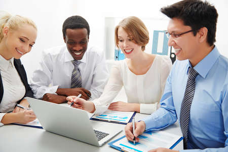 working attire: Group of business people having meeting together