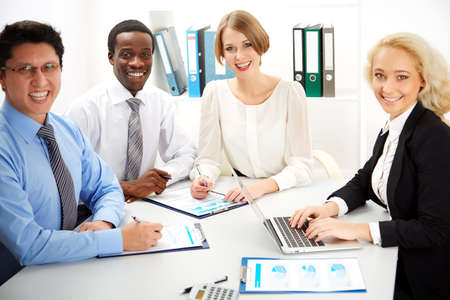 workplace wellness: International group of business people working together. Stock Photo