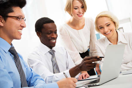 computer training: International group of business people working together. Stock Photo