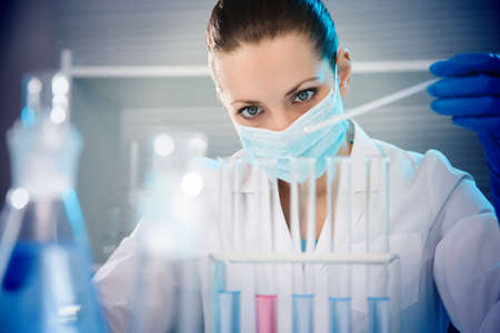 Attractive young female scientist working in laboratory photo