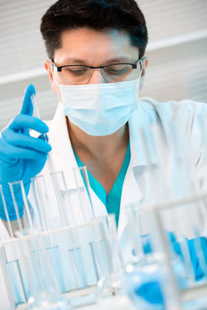 Young medical scientist working in laboratory photo