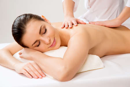 beauty girls: Masseur doing massage on the back of woman in the spa salon. Beauty treatment concept.