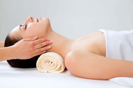 massage face: Masseur doing massage on woman face in the spa salon. Beauty treatment concept. Stock Photo