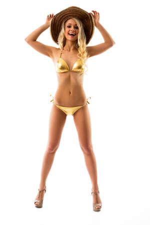 niñas en bikini: Delgado chica en bikini dorado y un sombrero