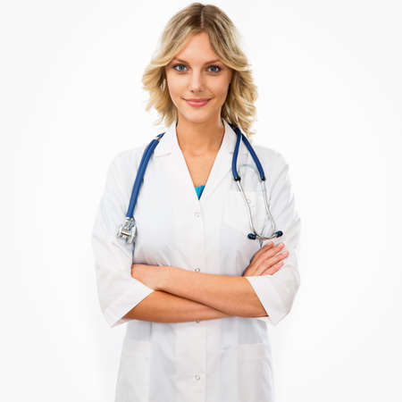 A female doctor standing isolated on white background