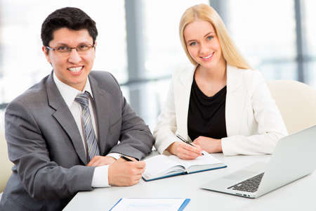 businesswoman suit: Business people having meeting in modern office