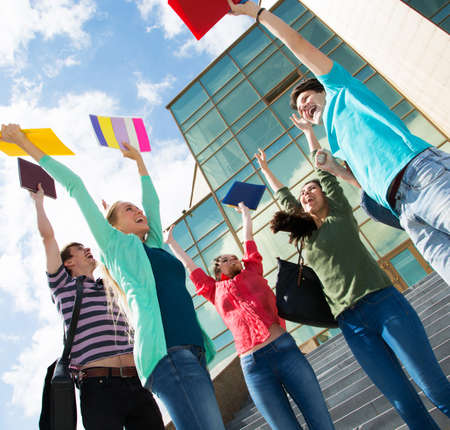 Happy students jumping for joy after the exam photo