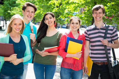 university text: Group of student with notebook outdoor
