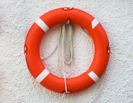 lifebuoy: Red lifebuoy on the wall